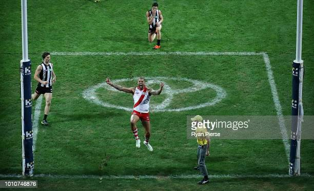 Lance Franklin of the Swans celebrates after Tom McCartin of the Swans kicked the winning goal during the round 20 AFL match between the Sydney Swans...