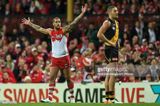 Lance Franklin of the Swans celebrates kicking a goal during the round 23 AFL match between the Sydney Swans and the Richmond Tigers at Sydney...