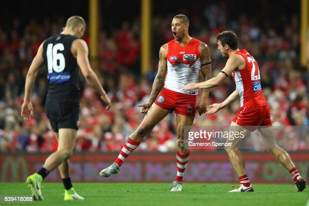 Lance Franklin of the Swans celebrates kicking a goal during the round 23 AFL match between the Sydney Swans and the Carlton Blues at Sydney Cricket...