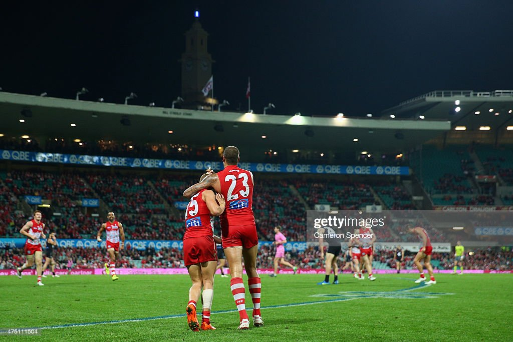 Lance Franklin of the Swans celebrates kicking a goal with team mate Kieren Jack during the round nine AFL match between the Sydney Swans and the Carlton Blues at SCG on May 29, 2015 in Sydney, Australia.