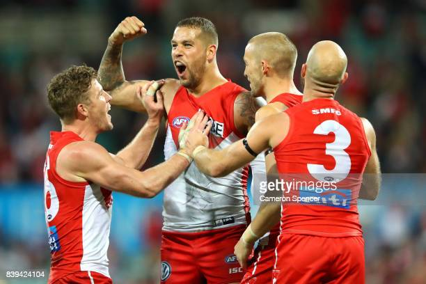 Lance Franklin of the Swans celebrates scoring his tenth goal during the round 23 AFL match between the Sydney Swans and the Carlton Blues at Sydney...