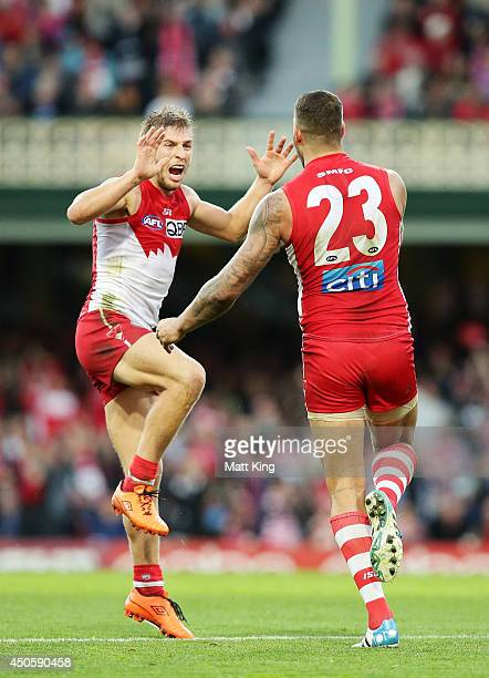 Lance Franklin of the Swans celebrates with Kieren Jack after kicking a goal during the round 13 AFL match between the Sydney Swans and the Port...