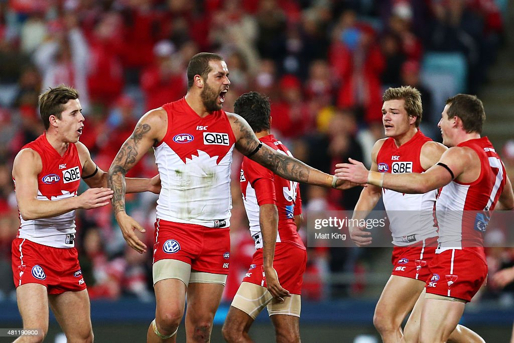 Lance Franklin of the Swans celebrates with team mates after kicking his 700th AFL goal during the round 16 AFL match between the Sydney Swans and the Hawthorn Hawks at ANZ Stadium on July 18, 2015 in Sydney, Australia.