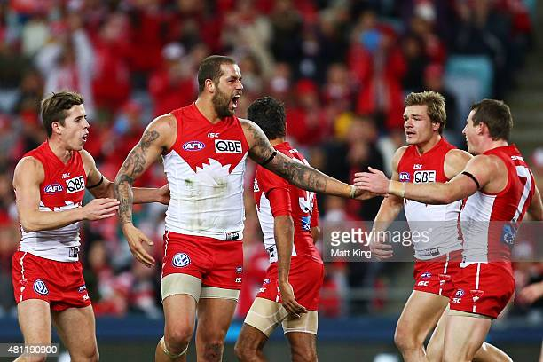 Lance Franklin of the Swans celebrates with team mates after kicking his 700th AFL goal during the round 16 AFL match between the Sydney Swans and...