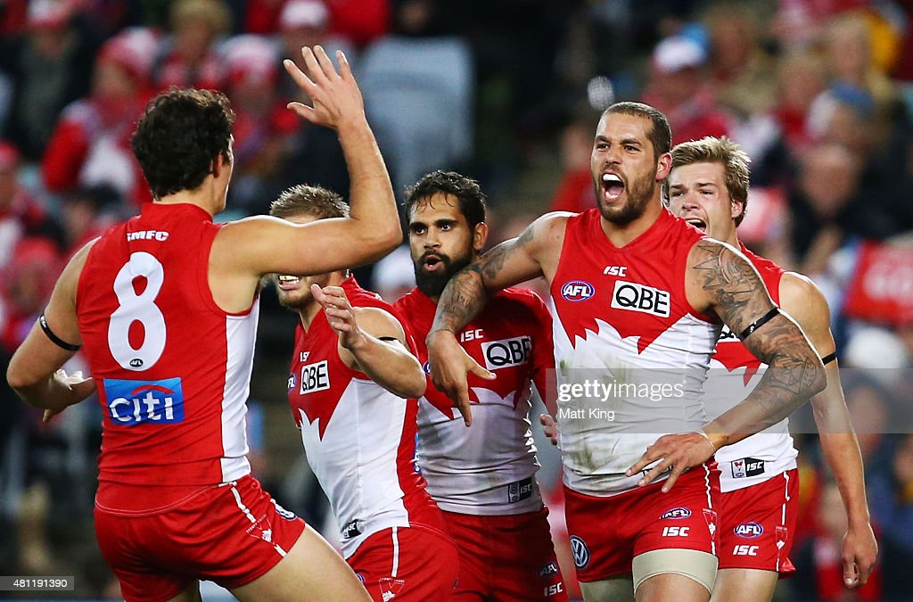 Lance Franklin of the Swans celebrates with team mates after kicking his third goal in the second quarter during the round 16 AFL match between the Sydney Swans and the Hawthorn Hawks at ANZ Stadium on July 18, 2015 in Sydney, Australia.