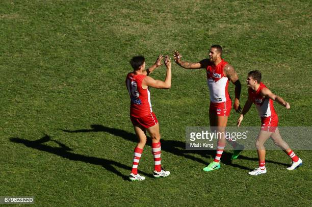 Lance Franklin of the Swans celebrates with team mates after kicking a long range goal during the round seven AFL match between the Sydney Swans and...