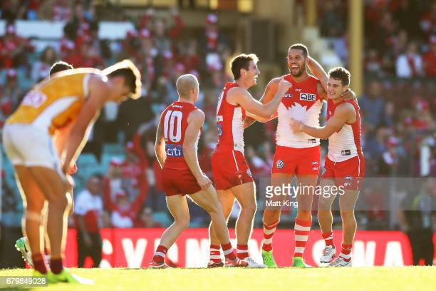 Lance Franklin of the Swans celebrates with team mates after kicking the final goal and victory during the round seven AFL match between the Sydney...