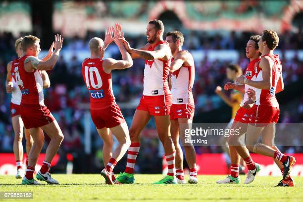 Lance Franklin of the Swans celebrates with team mates after kicking a goal during the round seven AFL match between the Sydney Swans and the...