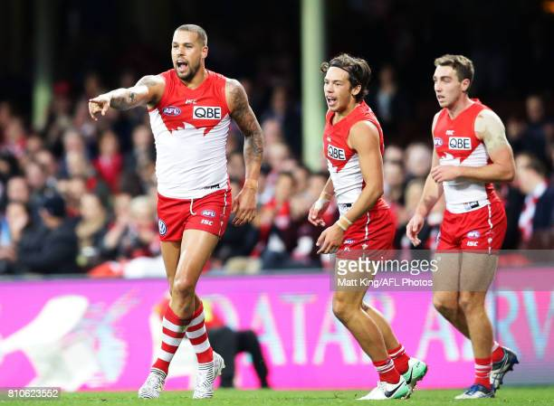 Lance Franklin of the Swans celebrates with team mates after kicking a goal during the round 16 AFL match between the Sydney Swans and the Gold Coast...