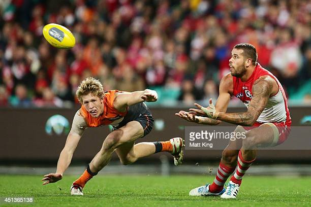Lance Franklin of the Swans competes for the ball against Sam Frost of the Giants during the round 15 AFL match between the Sydney Swans and the...