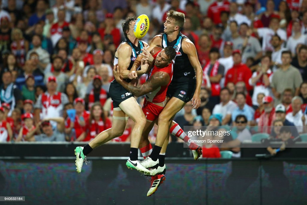 Lance Franklin of the Swans contests the ball with Jared Polec of the Power and Dougal Howard of the Power during the round two AFL match between the Sydney Swans and the Port Adelaide Power at the Sydney Cricket Ground on April 1, 2018 in Sydney, Australia.