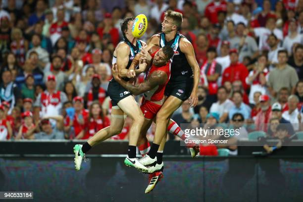 Lance Franklin of the Swans contests the ball with Jared Polec of the Power and Dougal Howard of the Power during the round two AFL match between the...