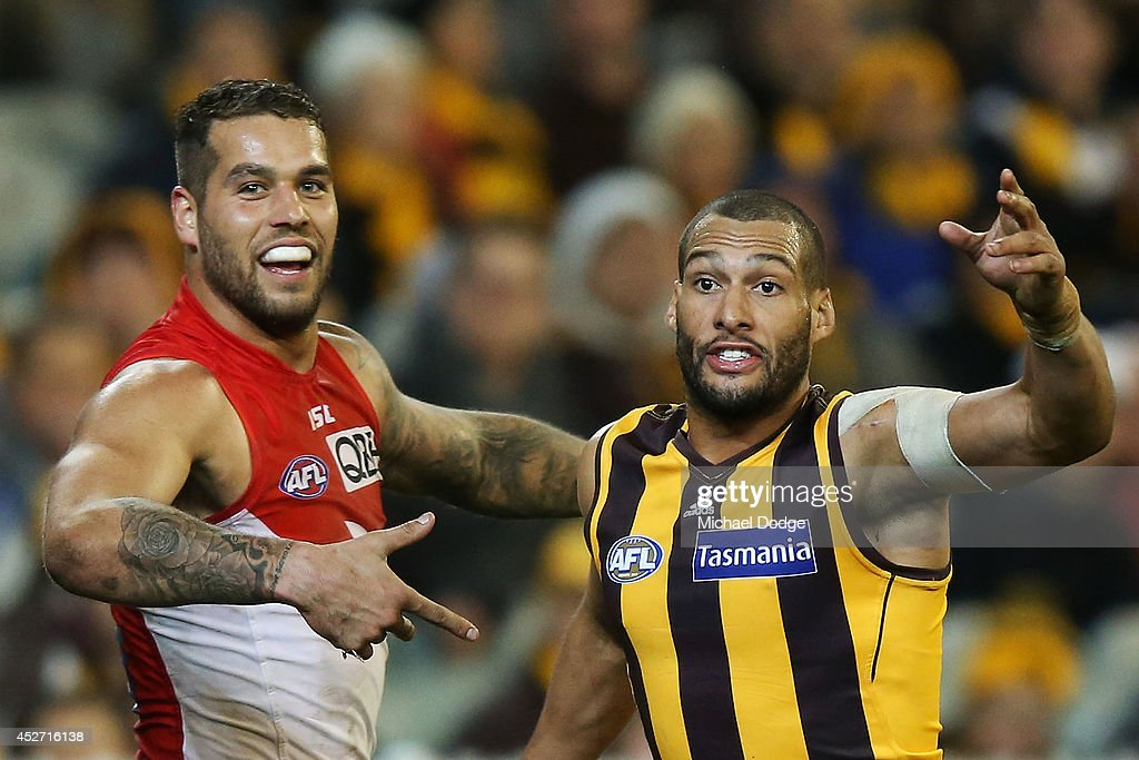Lance Franklin of the Swans gestures to Josh Gibson of the Hawks who claims he touched the ball when it was kicked for a goal during the round 18 AFL match between the Hawthorn Hawks and the Sydney Swans at Melbourne Cricket Ground on July 26, 2014 in Melbourne, Australia.