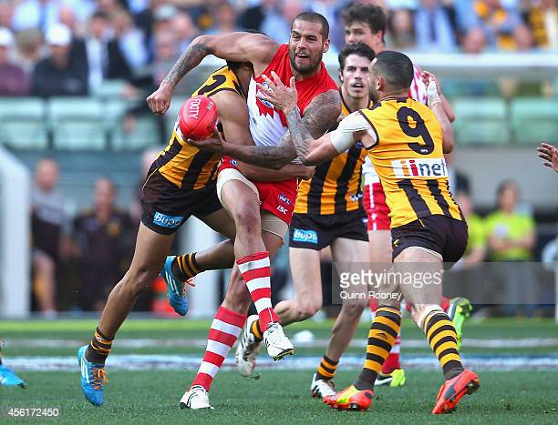 Lance Franklin of the Swans is tackled by Cyril Rioli of the Hawks during the 2014 AFL Grand Final match between the Sydney Swans and the Hawthorn...