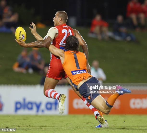 Lance Franklin of the Swans is tackled by Phil Davis of the Giants during the 2017 JLT Community Series AFL match between the Greater Western Sydney...