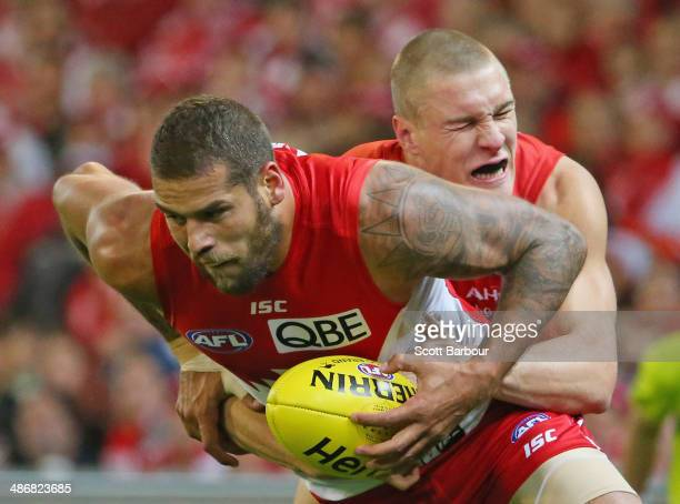 Lance Franklin of the Swans is tackled by Tom McDonald of the Demons during the round six AFL match between the Melbourne Demons and the Sydney Swans...
