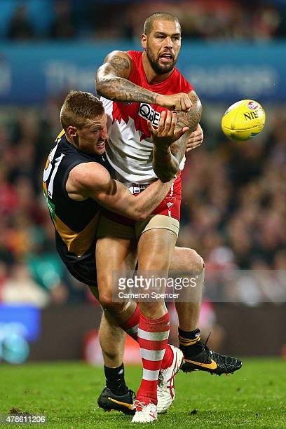 Lance Franklin of the Swans is tackled during the round 13 AFL match between the Sydney Swans and the Richmond Tigers at SCG on June 26 2015 in...