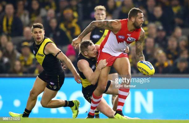 Lance Franklin of the Swans is tackled during the round 15 AFL match between the Richmond Tigers and the Sydney Swans at Etihad Stadium on June 28...