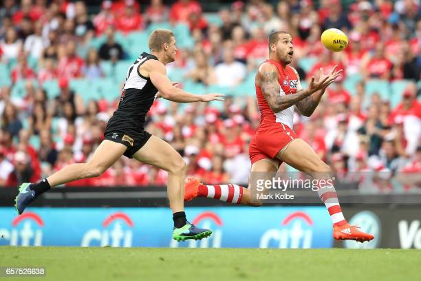 Lance Franklin of the Swans marks during the round one AFL match between the Sydney Swans and the Port Adelaide Power at Sydney Cricket Ground on...
