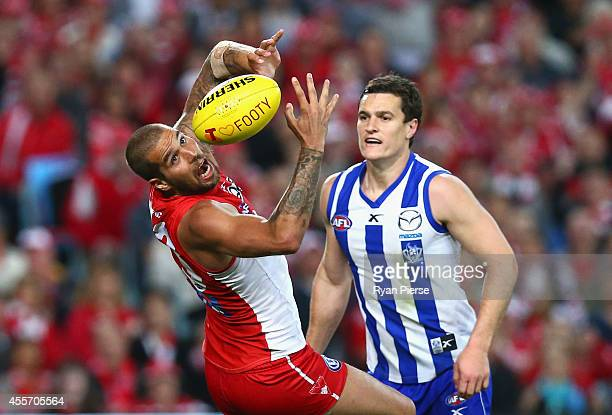 Lance Franklin of the Swans marks over Scott Thompson of the Kangaroos during the 1st Preliminary Final AFL match between the Sydney Swans and the...