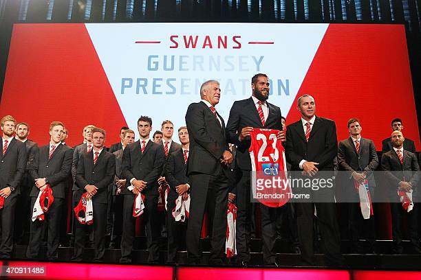 Lance Franklin of the Swans poses on stage with his 2014 Sydney Swans guernsey during the Sydney Swans AFL guernsey presentation and Hall of Fame...