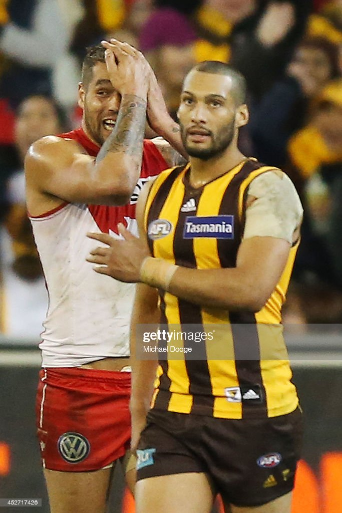 Lance Franklin of the Swans reacts behind Josh Gibson of the Hawks after defeat on the final siren during the round 18 AFL match between the Hawthorn Hawks and the Sydney Swans at Melbourne Cricket Ground on July 26, 2014 in Melbourne, Australia.