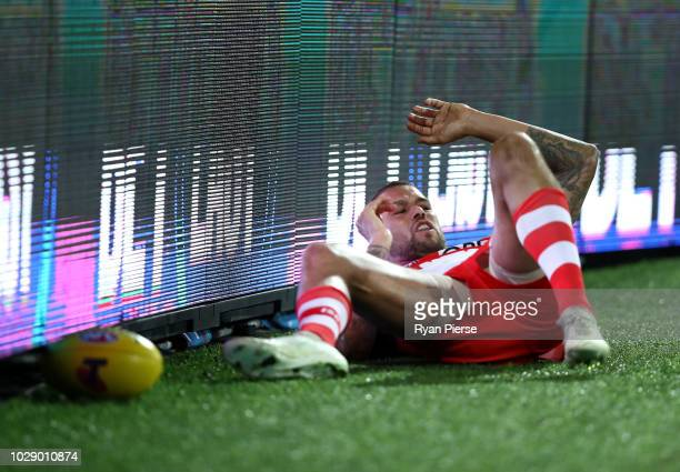 Lance Franklin of the Swans recovers after crashing into the signage during the AFL Second Elimination Final match between the Sydney Swans and the...