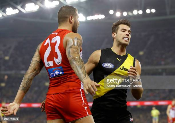 Lance Franklin of the Swans remonstrates with Alex Rance of the Tigers during the 2018 AFL round 15 match between the Richmond Tigers and the Sydney...