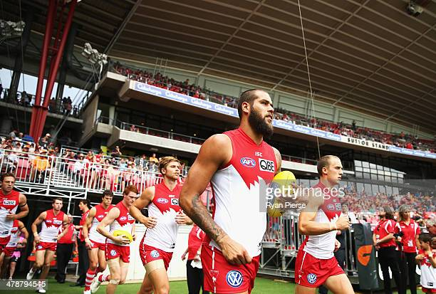 Lance Franklin of the Swans runs out onto the field during the round one AFL match between the Greater Western Sydney Giants and the Sydney Swans at...