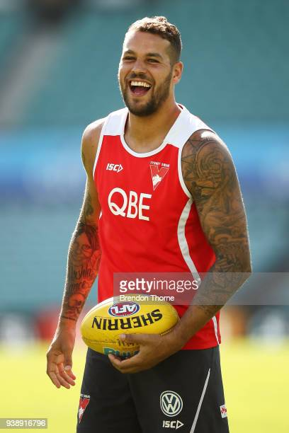 Lance Franklin of the Swans shares a joke with a team mate during a Sydney Swans AFL training session at SCG on March 28 2018 in Sydney Australia
