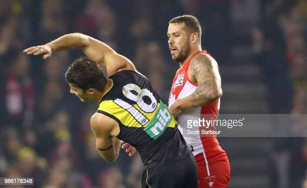 Lance Franklin of the Swans strikes Alex Rance of the Tigers during the round 15 AFL match between the Richmond Tigers and the Sydney Swans at Etihad...