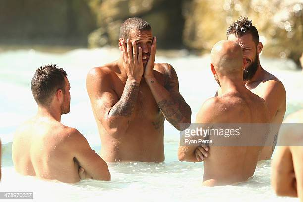 Lance Franklin of the Swans swims during a Sydney Swans AFL recovery session at Coogee Beach on March 16 2014 in Sydney Australia
