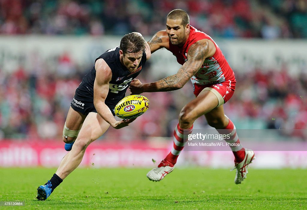 Lance Franklin of the Swans tackles Sam Docherty of the Blues during the round nine AFL match between the Sydney Swans and the Carlton Blues at SCG on May 29, 2015 in Sydney, Australia.