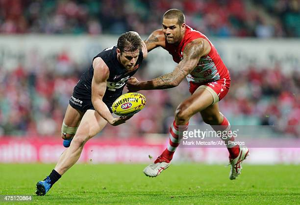 Lance Franklin of the Swans tackles Sam Docherty of the Blues during the round nine AFL match between the Sydney Swans and the Carlton Blues at SCG...