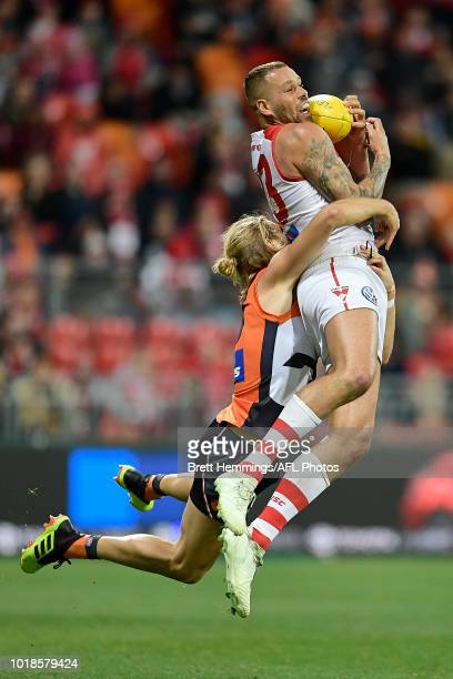 Lance Franklin of the Swans takes a mark over Nick Haynes of the Giants during the round 22 AFL match between the Greater Western Sydney Giants and...