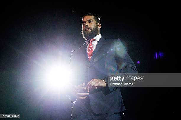Lance Franklin of the Swans walks on stage to receive his 2014 Sydney Swans guernsey during the Sydney Swans AFL guernsey presentation and Hall of...