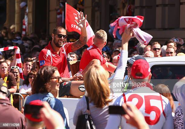 Lance Franklin of the Swans waves to the crowd during the 2014 AFL Grand Final Parade on September 26 2014 in Melbourne Australia