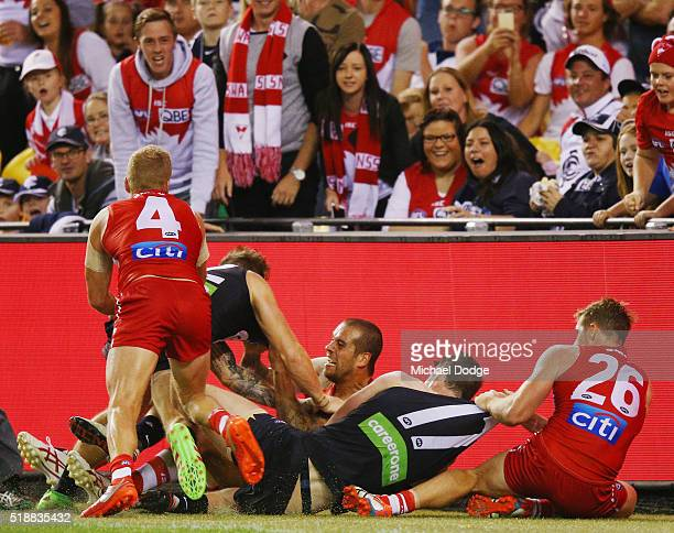 Lance Franklin of the Swans wrestles in this melee after he was pushed to the ground by Zach Tuohy of the Blues at half time during the round two...