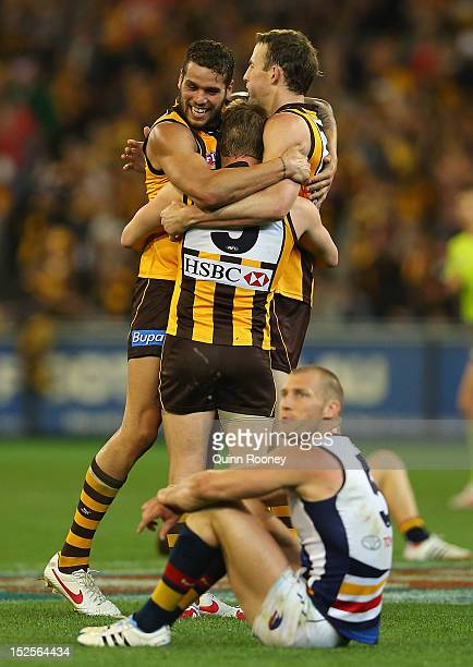 Lance Franklin Sam Mitchell and David Hale of the Hawks celebrates winning whilst Scott Thompson of the Crows looks dejected during the second AFL...