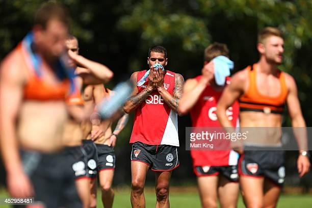 Lance Franklin wipes his face between running drills during a Sydney Swans AFL training session at Lakeside Oval on December 2 2013 in Sydney...