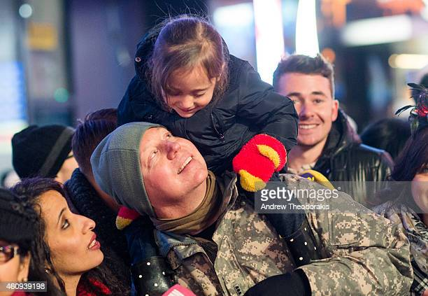 Lance Heppar and his daughter Shania Heppar from Washington DC join in as revelers celebrate New Year's Eve in Times Square on December 31 2014 in...