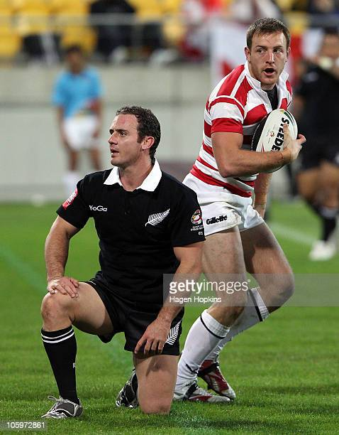 Lance Hohaia of the Kiwis shows his disappointment as James Roby of England stands up after scoring a try during the Four Nations match between the...