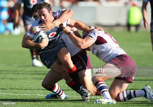 Lance Hohaia of the Warriors is tackled during the NRL trial match between the Warriors and the Manly Warringah Sea Eagles at North Harbour Stadium...