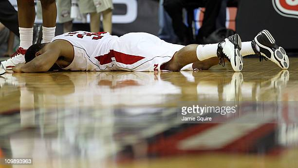 Lance Jeter of the Nebraska Cornhuskers lays on the court after losing the ball in the final moments of their game against the Oklahoma State Cowboys...