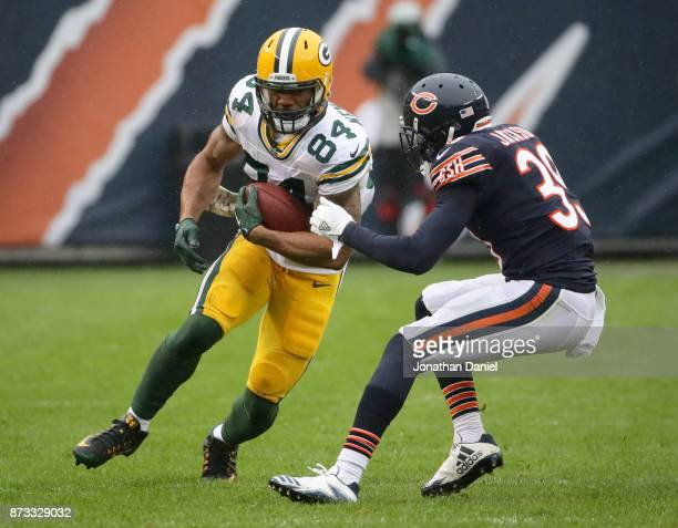 Lance Kendricks of the Green Bay Packers carries the football against Eddie Jackson of the Chicago Bears in the third quarter at Soldier Field on...