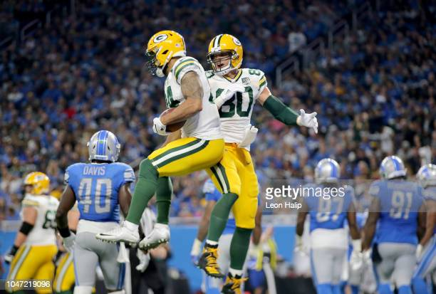 Lance Kendricks of the Green Bay Packers celebrates his touchdown with teammate Jimmy Graham against the Detroit Lions during the second half at Ford...