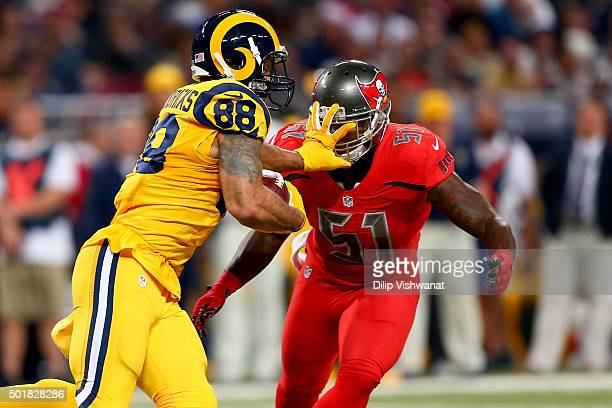 Lance Kendricks of the St Louis Rams fends off Danny Lansanah of the Tampa Bay Buccaneers as he carries the ball in the second quarter at the Edward...