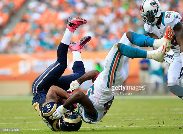 Lance Kendricks of the St Louis Rams is tackled by Kevin Burnett of the Miami Dolphins at Sun Life Stadium on October 14 2012 in Miami Gardens Florida