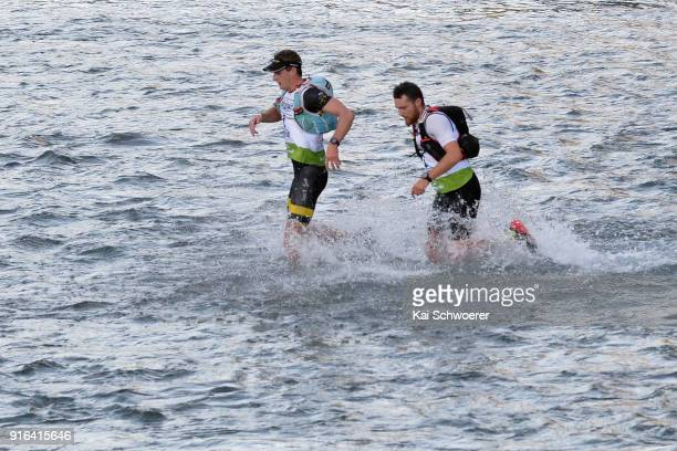 Lance Kime of South Africa and James Pretto of Australia compete in the mountain running stage of the 1 day individual competition during the...