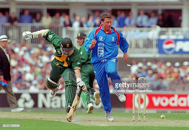 Lance Klusener of South Africa makes his ground as Darren Gough of England kicks the ball into the stumps during the World Cup Group match between...